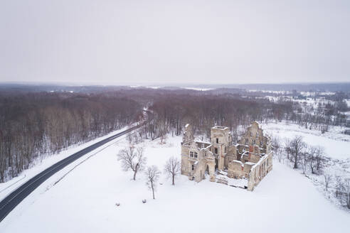 Aerial view of Ungru Lossi Varemed ruins of an old manor covered with snow near Haapsalu, Estonia - AAEF02463
