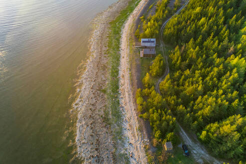Aerial view of an isolated houses in the edge of a forest in Forby on Vormsi island, Estonia - AAEF02535