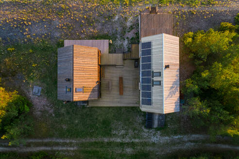 Aerial view of an isolated houses in the edge of a forest in Forby on Vormsi island, Estonia. - AAEF02541