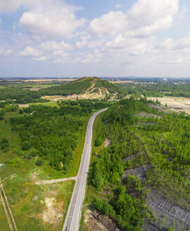 Aerial view road going through forest and village, Estonia - AAEF02643