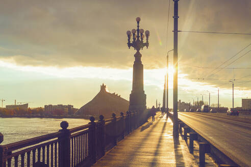 Sunset over Akmens Tilts bridge and the University Library in background, Riga, Latvia - TAMF02094