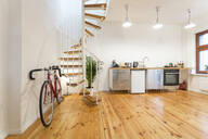 Interior of a modern apartment with bike - TAMF02139