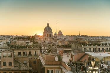 The skyline of Rome with San Carlo al Corso and St. Peter's Basilica before sunset seen from the Spanish Steps, Italy - TAM02163