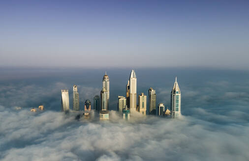 Aerial view of skyscrapers in the clouds of Dubai, UAE - AAEF02759
