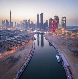 Aerial view of canal and illuminated skyscrapers in downtown Dubai at night, U.A.E. - AAEF02780