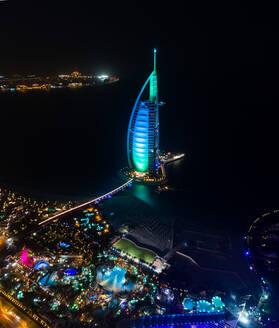 Aerial view of the luxurious Burj Al Arab Hotel by night in Dubai bay, UAE - AAEF02792