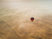 Aerial view of hot-air-balloon flying in the clouds of the Murqquab desert in Dubai, UAE - AAEF02888