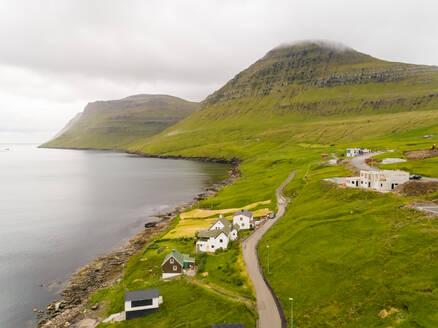 Aerial view of small village on the shore of north Atlantic sea, Faroe island - AAEF02966