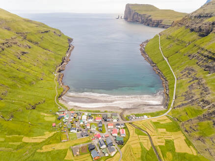 Aerial view of small village surrounding by mountain elevations, Faroe island - AAEF02978