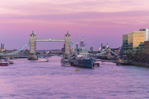 Tower Bridge with HMS Belfast at sunset with purple sky above the River Thames, London, England, United Kingdom, Europe - RHPLF00554