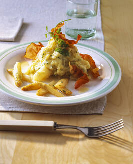 Asparagus with mashed potatoes and fried bacon in plate on table - PPXF00257
