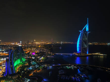 Aerial view of the luxurious Burj Al Arab Hotel by night in Dubai, United Arab Emirates. - AAEF03323