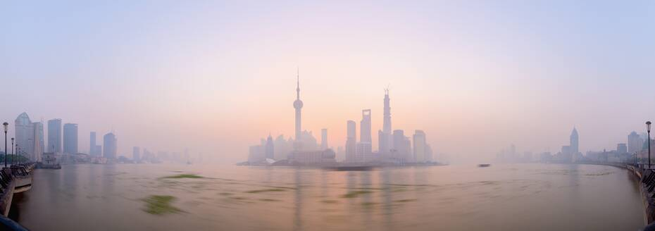 Pudong skyline across Huangpu River, including Oriental Pearl Tower, Shanghai World Financial Center, and Shanghai Tower, Shanghai, China, Asia - RHPLF01106