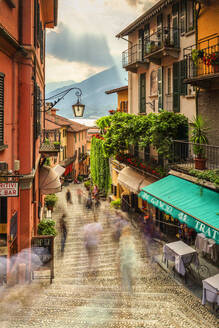 Tourists walk stairs in Bellagio, Province of Como, Lake Como, Italian Lakes, Lombardy, Italy, Europe - RHPLF01703