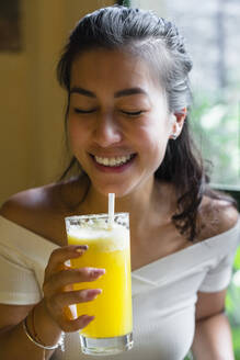 Young woman enjoying a smoothie - MGIF00679
