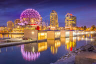 View of False Creek and Vancouver skyline, including World of Science Dome at dusk, Vancouver, British Columbia, Canada, North America - RHPLF02199