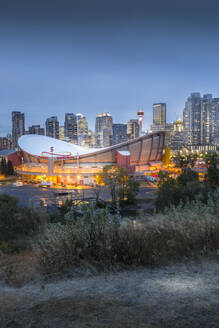 View of the Saddledome and Downtown skyline from Scottsman Hill at dusk, Calgary, Alberta, Canada, North America - RHPLF02391