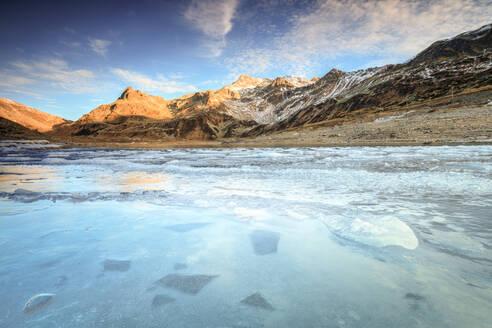 Frozen lake Montespluga at dawn, Chiavenna Valley, Sondrio province, Valtellina, Lombardy, Italy, Europe - RHPLF02907