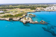 Aerial view of Roca Vecchia against sky during sunny day - AMF07289