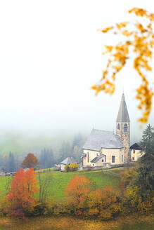 Church of Santa Magdalena in the autumn mist, Funes Valley, Sudtirol (South Tyrol), Dolomites, Italy, Europe - RHPLF03168