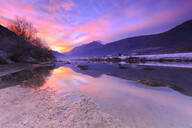 The colors of sunset are reflected in the Adda River, Valtellina, Lombardy, Italy, Europe - RHPLF03174
