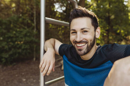 Portrait of happy man at fitness trail - MFF04795