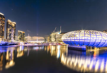 Illuminated Webb Bridge over Yarra river in Docklands against sky at night, Melbourne, Australia - SMAF01321