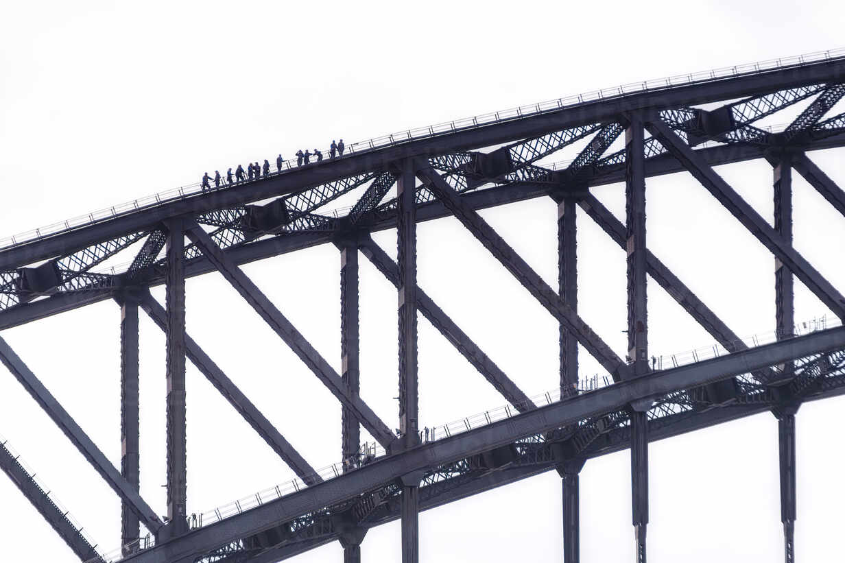 Silhouette people climbing Sydney Bridge against clear sky, Australia - SMAF01324 - Scott Masterton/Westend61