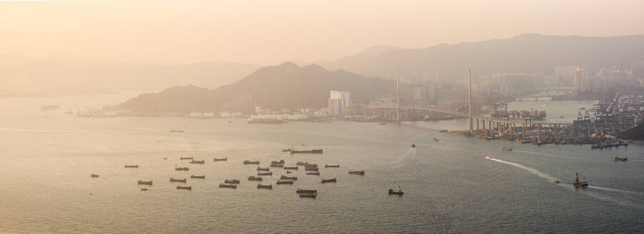 Boats in Victoria Harbour at sunset, seen from Victoria Peak, Hong Kong Island, Hong Kong, China, Asia - RHPLF03604