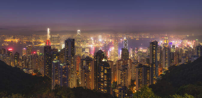 Hong Kong city skyline at night, showing the Central and Kowloon area, viewed from Victoria Peak, Hong Kong, China, Asia - RHPLF04524
