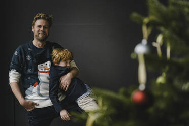Father and son having fun together at Christmas time - KNSF06283