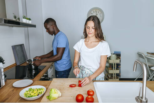 Couple cooking together in kitchen - KIJF02649
