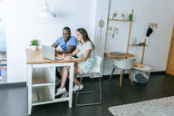 Couple using laptop at home - KIJF02655