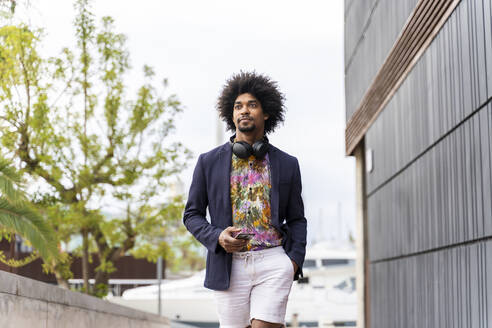 Stylish man in the city on the go - AFVF03860