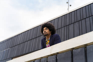 Portrait of stylish man behind a wall - AFVF03866