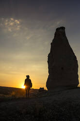 Young woman at sunset, Cappadocia, Turkey - KNTF03089