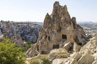 Carved rock formations against clear sky at Goreme Open Air Museum, Cappadocia, Turkey - KNT03127
