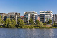 Modern apartments in front of river against clear sky at Frankfurt, Germany - WDF05436