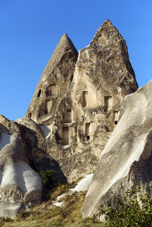 Scenic view of Dove complex monastery against clear blue sky in Goreme, Cappadocia, Turkey - KNTF03207