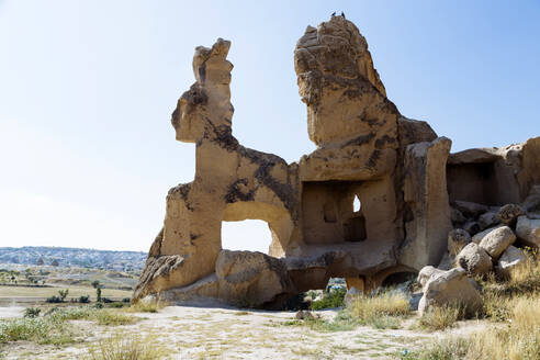 Scenic view of rock formations against clear sky at Dove valley, Cappadocia, Turkey - KNTF03210