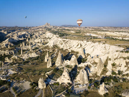 Aerial view of hot air balloons flying over landscape at Uchisar, Cappadocia, Turkey - KNTF03240