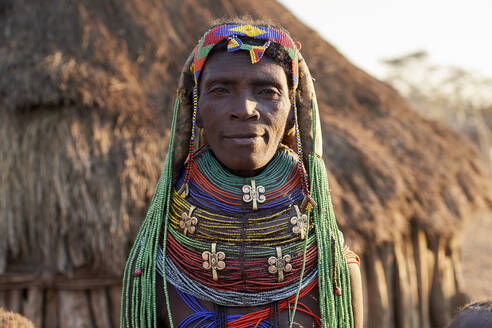 Muhila woman with her characteristic hairstyle and necklaces, Kehamba, Chibia, Angola. - VEGF00540