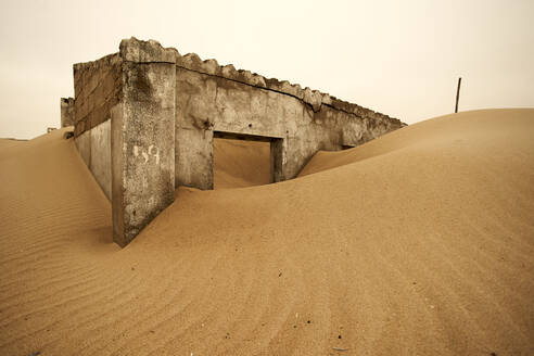Remainings of a colonial Portuguese house at the abandoned village of Ilha dos Tigres, Angola - VEGF00558