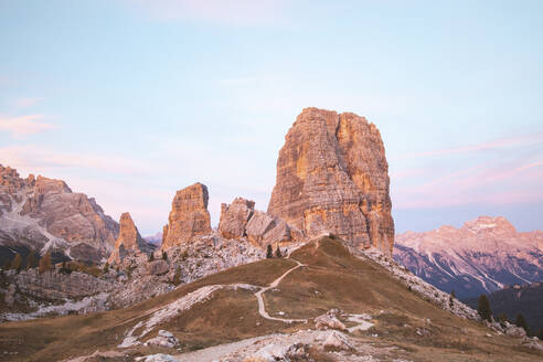 Scenic view of Cinque Torri and mountain range against sky during sunset, Italy - WPEF01820