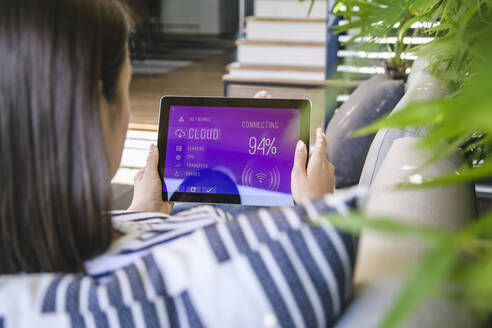Young woman with tablet with smart home control functions - UUF18837