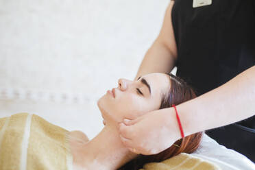 Young woman receiving facial beauty treatment in a spa - LJF00861