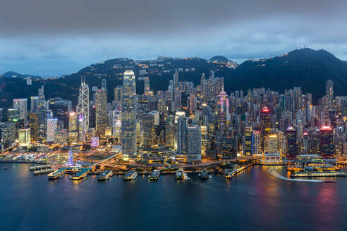 Elevated view, Harbour and Central district of Hong Kong Island and Victoria Peak, Hong Kong, China, Asia - RHPLF05130