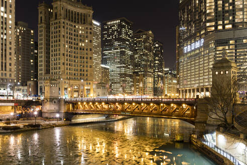 Trump Tower and frozen Chicago River at night, Chicago, Illinois, United States of America, North America - RHPLF05571