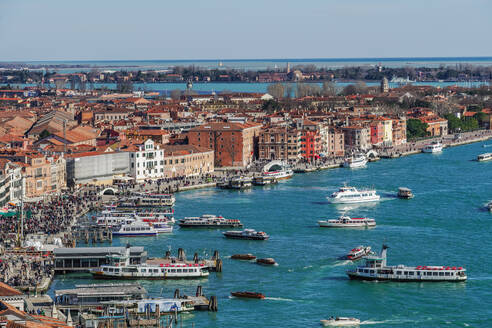 Panoramic day view of waterfront with boats and low rise buildings with red tiles, seen from St. Marks Campanile, Venice, UNESCO World Heritage Site, Veneto, Italy, Europe - RHPLF05868
