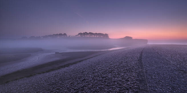 Winter twilight and heavy band of mist from River Otter at Budleigh Salterton, Devon, England, United Kingdom, Europe - RHPLF06363